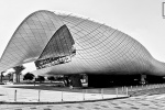 A black and white panoramic view of the contemporary architecture of the Etihad Museum, Dubai, UAE