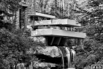 A long-exposure black and white view of Fallingwater, the famous home in Pennsylvania built by architect Frank Lloyd Wright.