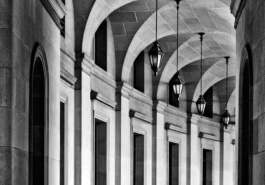 A black and white architectural photo of an archway in Federal Triangle in Washington DC