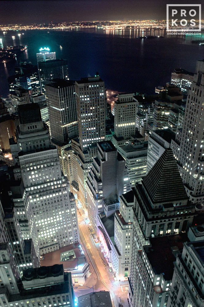 An aerial view of Lower Manhattan, The Financial District, and New York Harbor at night
