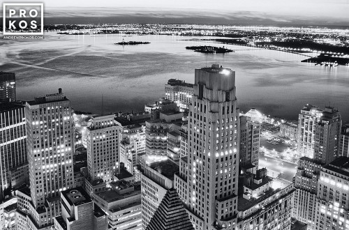 A black and white cityscape photo of New York City's Financial District and New York Harbor