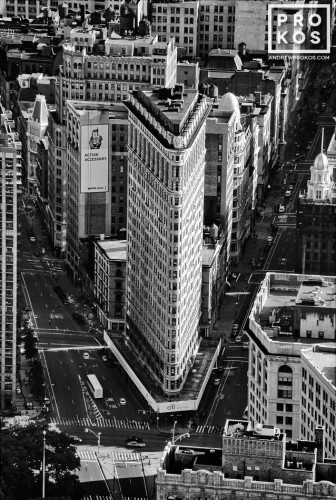 A black and white fine art photo of the Flatiron Building and surrounding buildings in Manhattan, NYC as seen from above