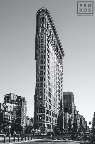 A fine art architectural photo of the Flatiron Building from Broadway in black and white, New York City