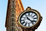 A fine art architectural photo of the New York's Flatiron Building and the Fifth Avenue Clock