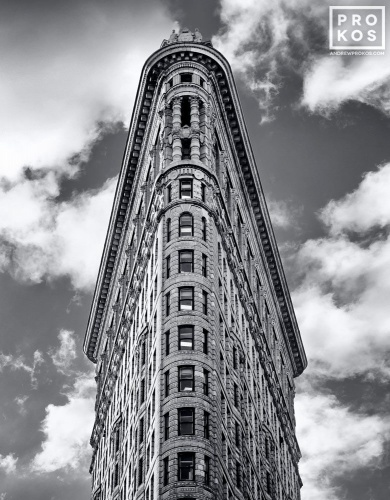 A black and white fine art architectural photo of the Flatiron Building set against the sky, New York City