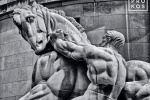 A black and white fine art photo of the statue of Man Controlling Trade at the Federal Trade Commission in Washington DC