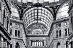 A black and white interior photo of the Galleria Vittorio Emanuele, Naples, Italy