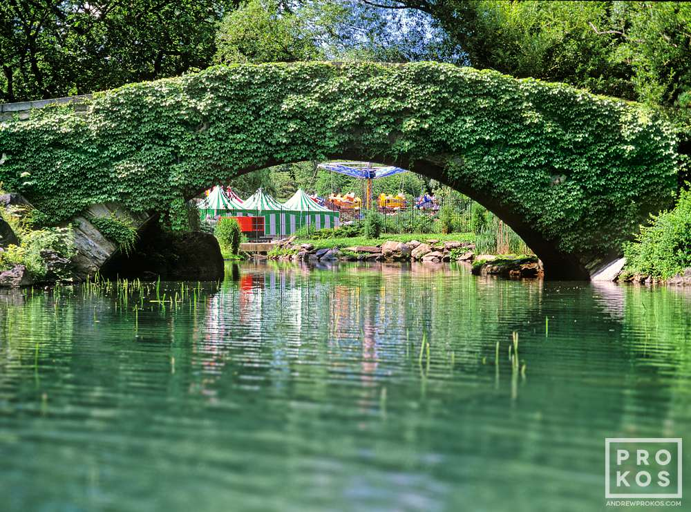 A landscape photo of Central Park's Gapstow Bridge in the summer, New York City