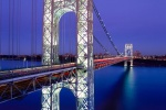 A long-exposure architectural photo of the George Washington Bridge at dusk, New York City
