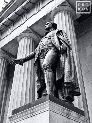The bronze statue of George Washington at Federal Hall on Wall Street in black and white, New York City