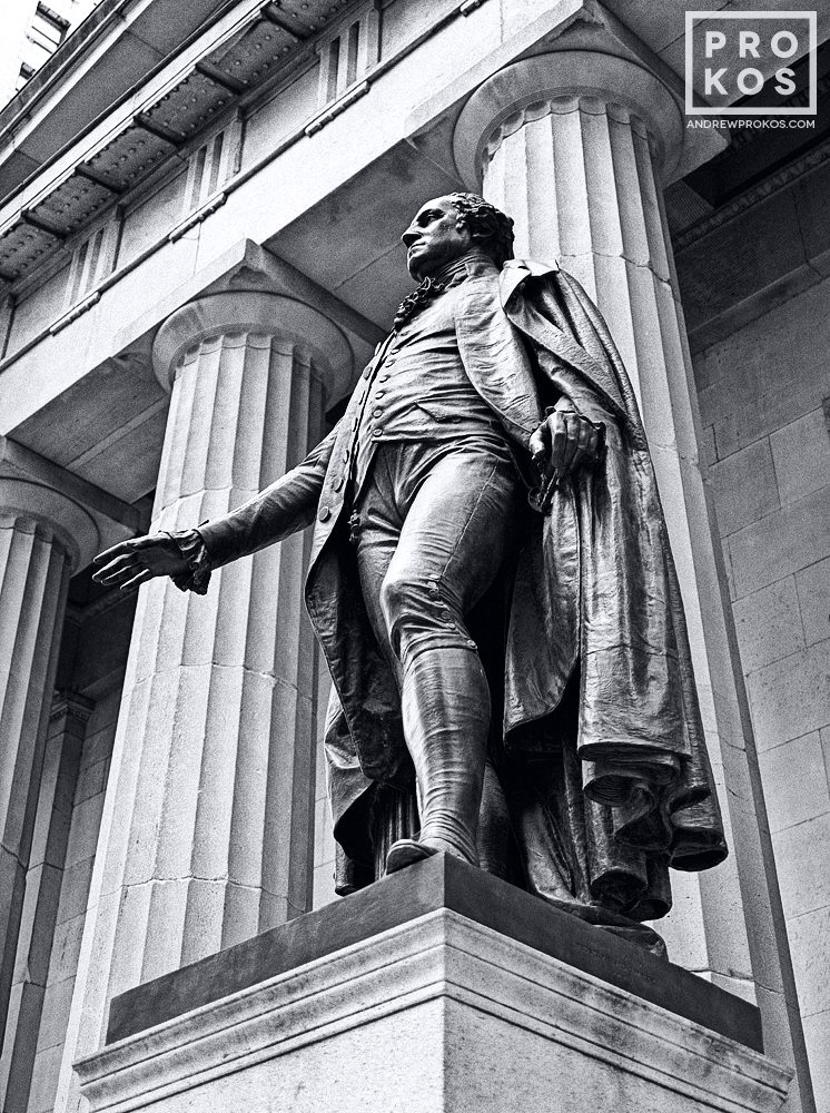 A black and white fine art photo of the bronze statue of George Washington at Federal Hall on Wall Street, New York City
