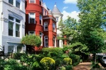 A photo of the historic rowhouses along Georgetown's P Street in summer, Washington DC