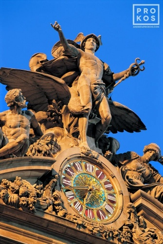 A fine art architectural photo of the Mercury clock on the facade of Grand Central Station at dusk, New York City