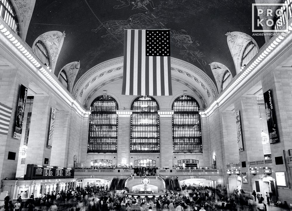 A black and white fine art photo of Grand Central Station's main hall at rush hour, New York City.
