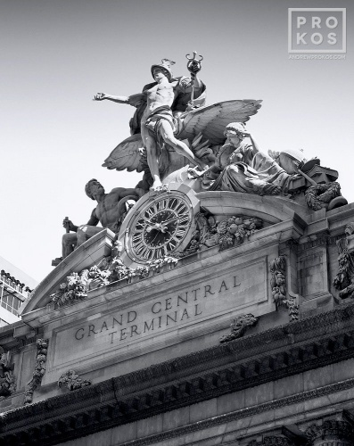 A fine art architectural photograph of Grand Central Station's facade and Mercury Clock in black and white, New York City