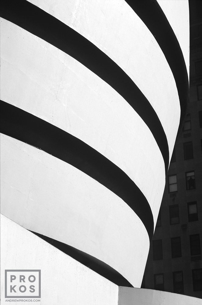 An exterior view of the Guggenheim Museum exterior in black and white, New York City