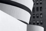 A black and white fine art photo of the Guggenheim Museum exterior, New York City
