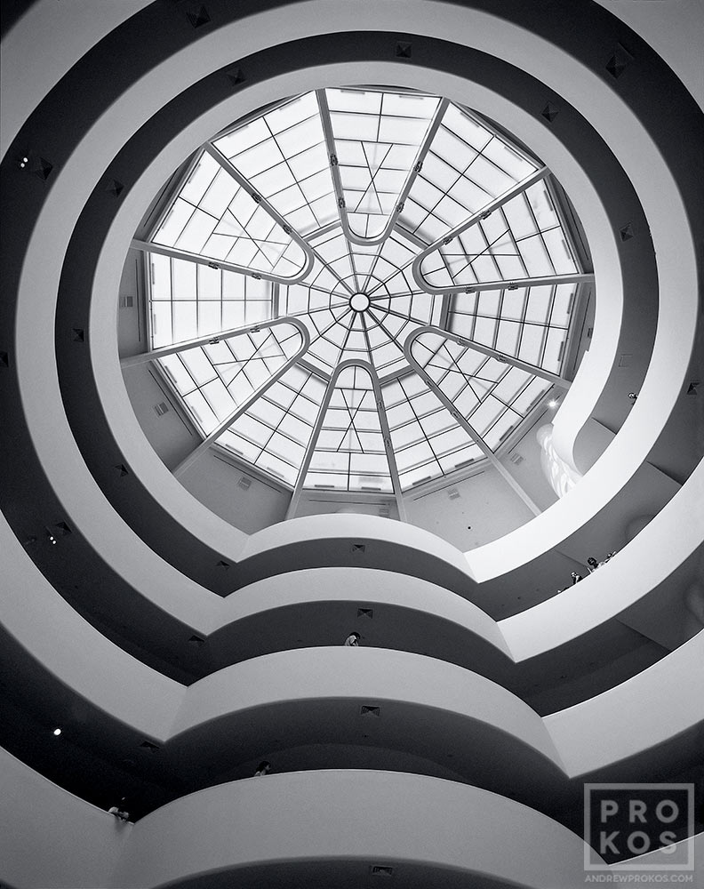 A fine art architectural photograph of the Guggenheim Museum rotunda in black and white, New York City