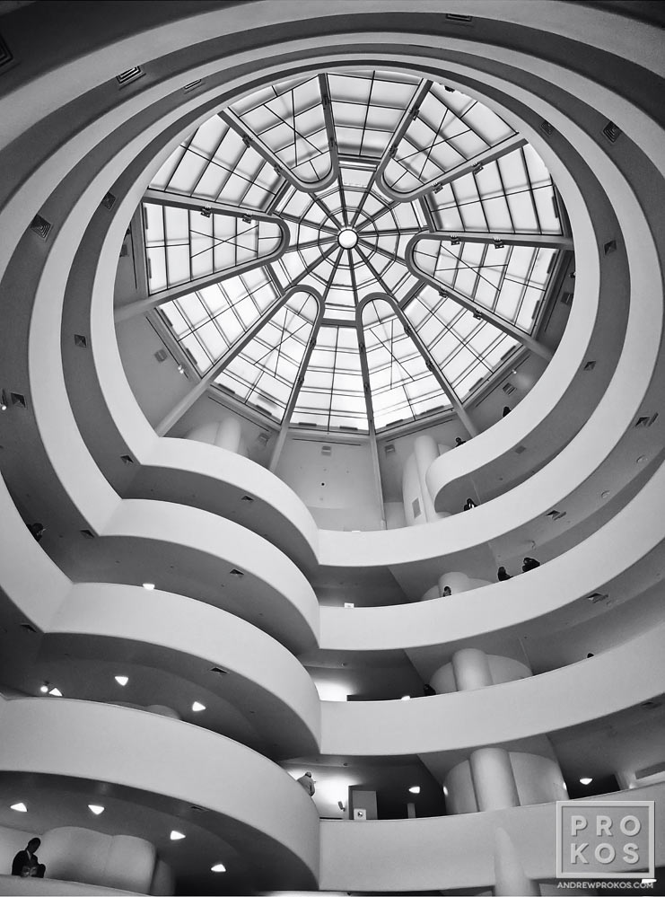An architectural interior of the Guggenheim Museum in black and white, New York City