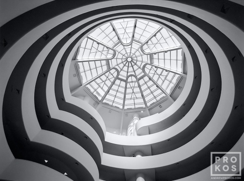 A fine art architectural photograph of the Guggenheim Museum rotunda in black and white, New York City.