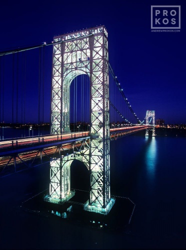 A long-exposure photo of the George Washington Bridge at night, New York City.