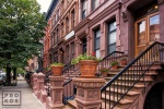 A fine art architectural photo of a block of elegant Brownstones in the Mt. Morris section of Harlem, New York City