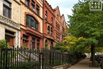A fine art architectural photo of the elegant brownstones in the Sugar Hill area of Harlem, NYC