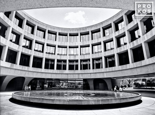 A black and white architectural photo of the Hirshhorn Museum and plaza in Washington DC