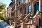 A fine art architectural photo of a row of brownstones along Hudson Street in Hoboken, New Jersey
