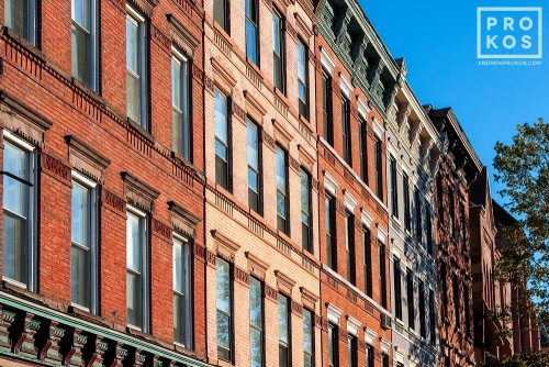 An architectural photo of a row of tenement building facades along Washington Street in Hoboken, New Jersey