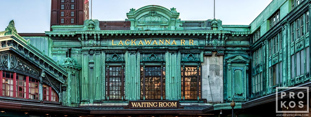 A panoramic format architectural photo of the ornate facade of Hoboken Terminal, New Jersey