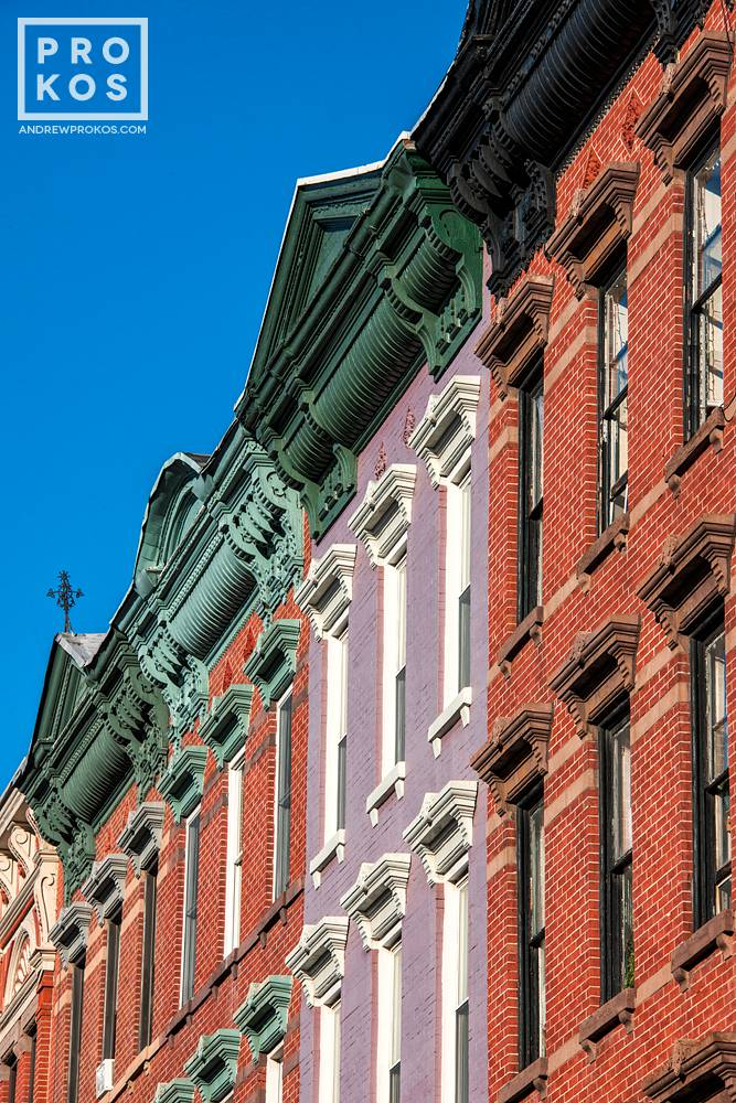 A row of tenement building facades along Washington Street in Hoboken, New Jersey