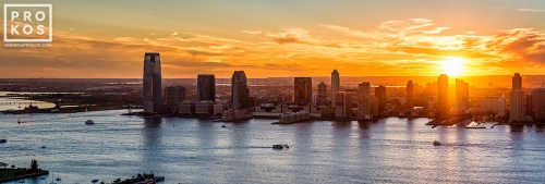 A panoramic view of Jersey City, New Jersey and the Hudson River at sunset.