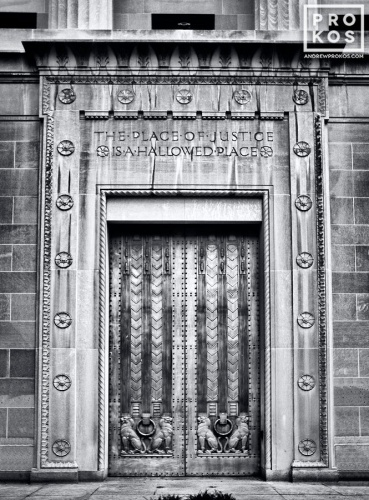 A black and white fine art architectural photo of the Art Deco doors at the United States Department of Justice building, Washington DC