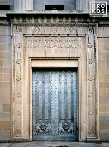 An architectural photo of the art deco doors at the United States Department of Justice building, Washington DC