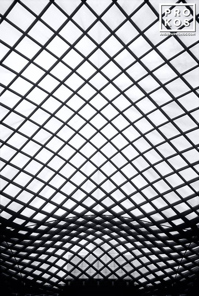 An architectural detail from the undulating glass and steel roof which covers Kogod Courtyard, located between the National Portrait Gallery and the Smithsonian Museum of American Art, Washington DC.