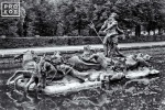 A photo of the statue of Neptune with horse chariot in the gardens at La Granja de San Ildefonso, Spain in black and white