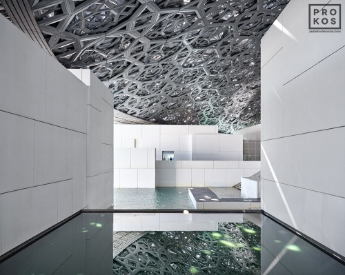 An architectural photo of the Interior of the Louvre Museum in Abu Dhabi, UAE by architect Jean Nouvel.