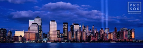 An ultra high-definition panoramic skyline of Lower Manhattan at dusk with Towers of Light commemorating 9/11. Large-format fine art prints of this photo are available up to 120 inches wide.