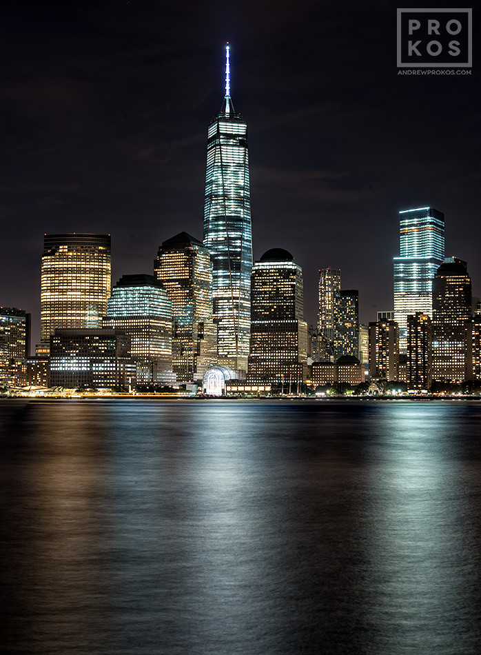 A long-exposure cityscape photo of Lower Manhattan, Hudson River, and the World Trade Center at night. Large format fine art prints of this photo are available up to 84 inches in height.