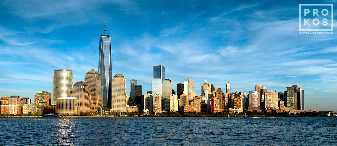 A panoramic skyline of Lower Manhattan, Hudson River, and the World Trade Center during the day as seen from New Jersey.