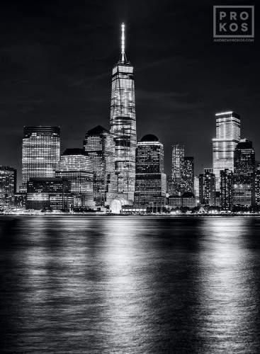 Lower manhattan skyline and world trade center at night bw a black and white