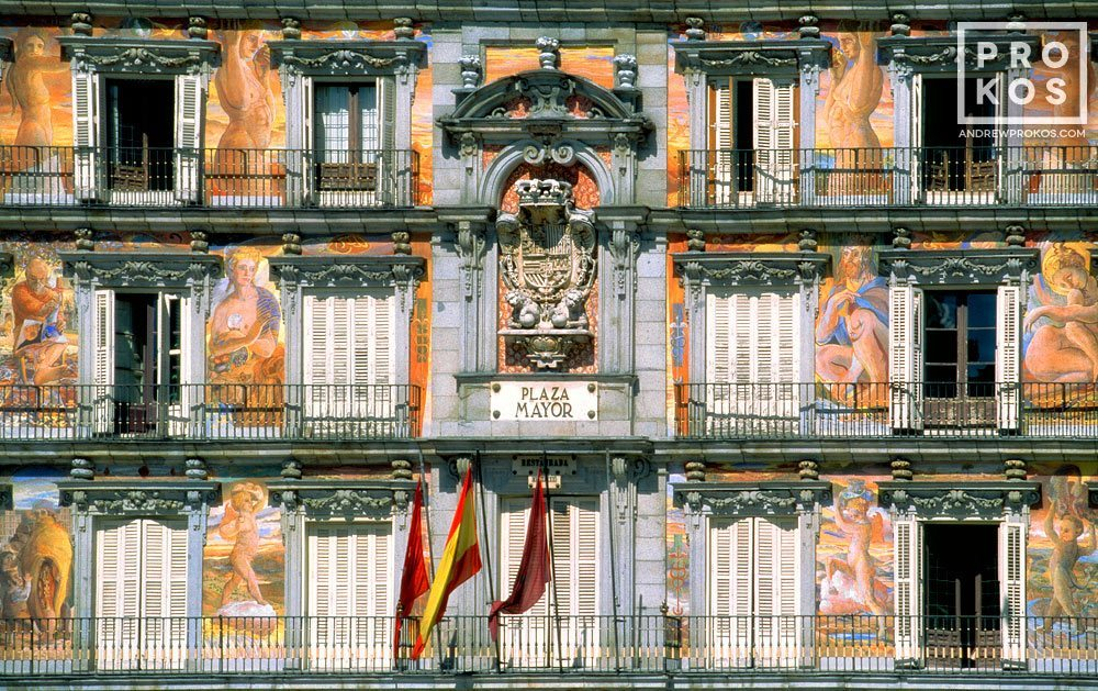 A color architectural photo of the decorative murals adorning the facade of the Panaderia in the Plaza Mayor, Madrid, Spain