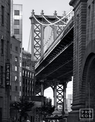 A black and white photo of the Manhattan Bridge as seen from Downtown Brooklyn, New York City
