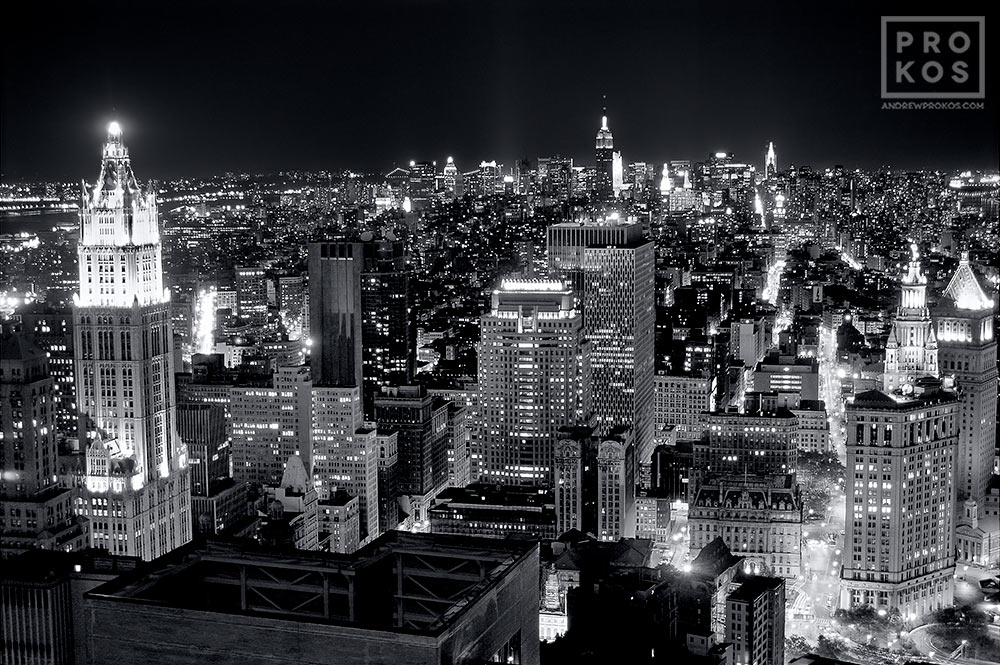 A black and white aerial view of the skyscraper of Lower Manhattan at night, New York City
