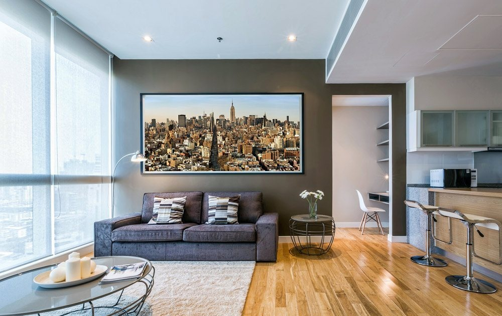 Large scale color cityscape of Manhattan by photographer Andrew Prokos in a luxury loft apartment