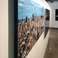 A framed metal print of a panoramic cityscape of Manhattan as seen from Soho by photographer Andrew Prokos
