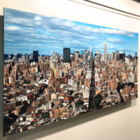 A limited edition metal print of a panoramic cityscape of Manhattan as seen from Soho by photographer Andrew Prokos