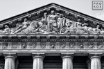 A black and white architectural photo of the pediment from the Mellon Auditorium building in Washington DC