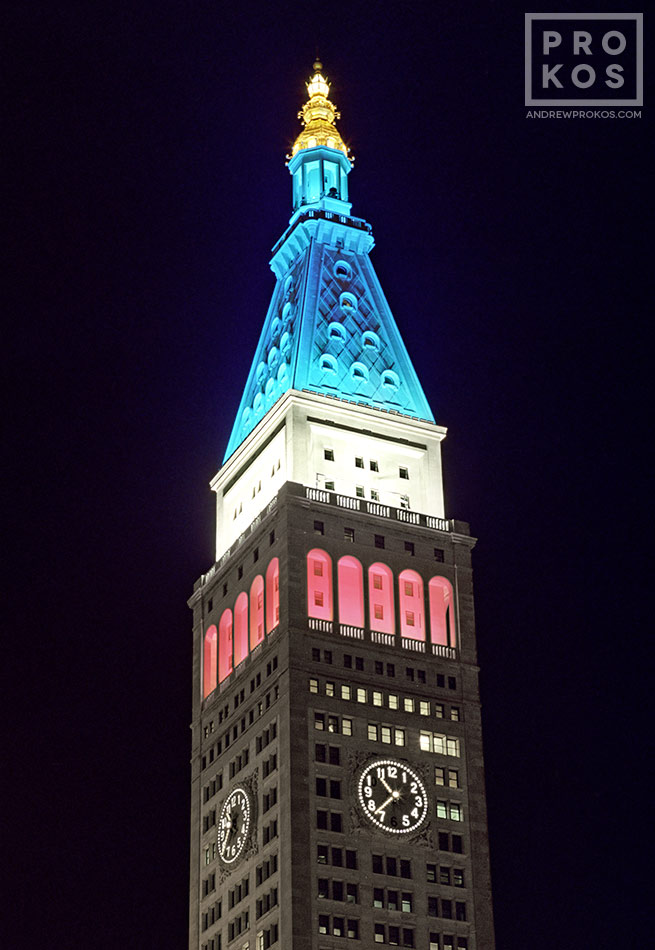 A view of the MetLife Building's tower and cupola at night in red, white and blue, New York City
